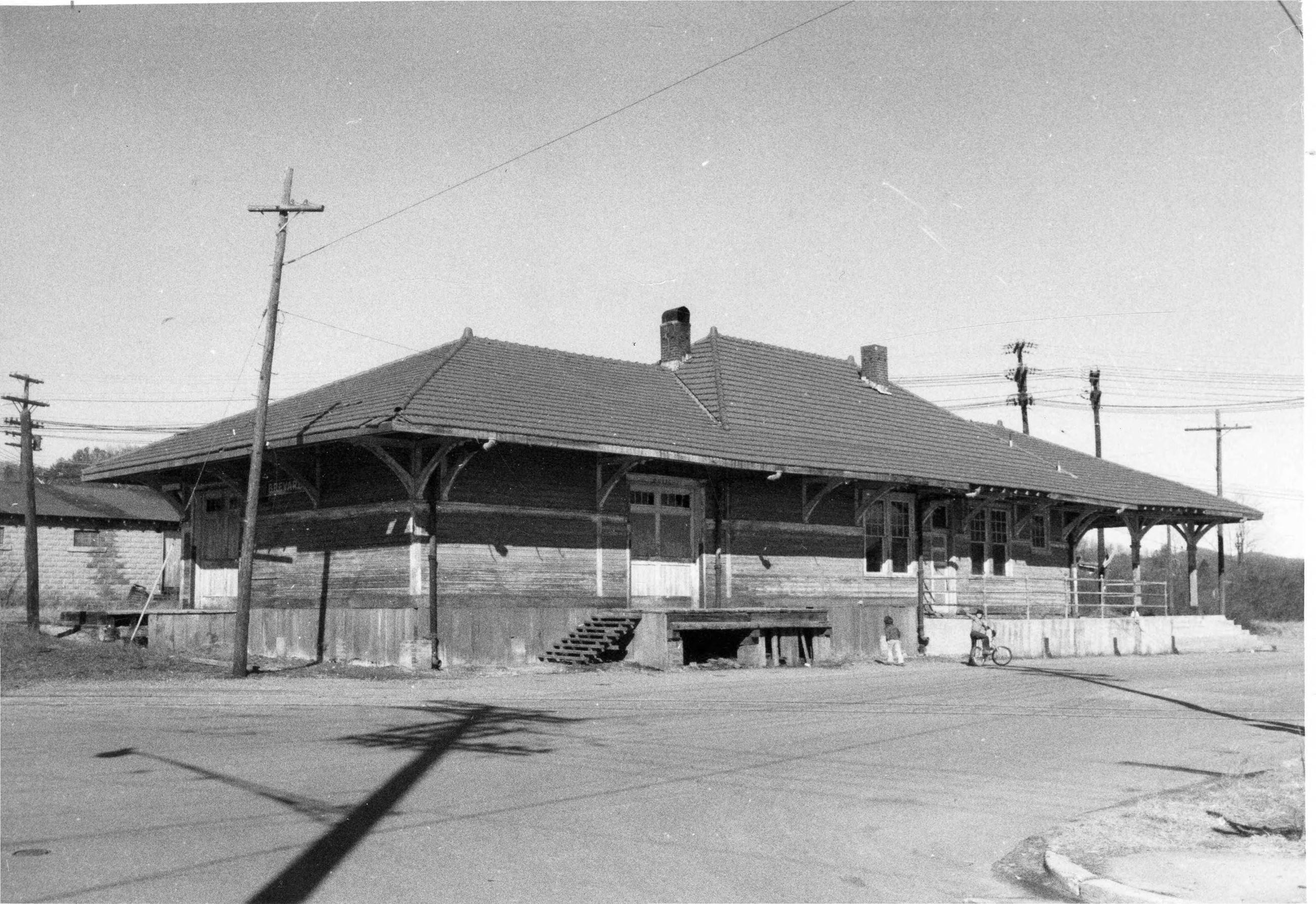 Black and white photo of an old train depot